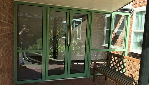 green aluminium door